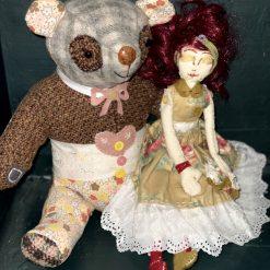 Teddy bear and doll