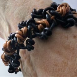 "Black 'n' tan leather thong bracelet 8.5"" long"