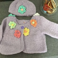 Handknitted cardigan and hat set