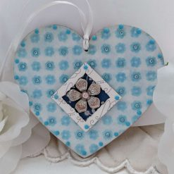 Decoupaged pale blue flowers wooden heart hanging decoration with metal flower and crystals
