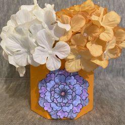 hexagonal box with orange and cream hydrangeas