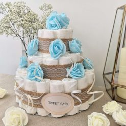 Stunning Nappy Cake adorned with Roses. A wonderful gift for new parents or baby shower.
