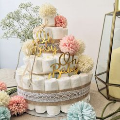 Contemporary Nappy Cake adorned with flowers. A wonderful gift for new parents or baby shower.