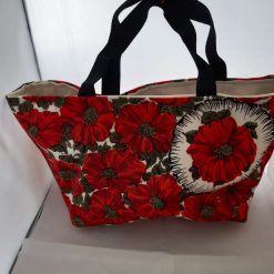 Small lined tote in a canvas fabric with interior patch pocket and d ring for keys ect