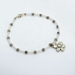 Beaded opalescent anklet with star beads and daisy dangle