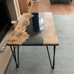 Pippy oak and black resin river coffee table