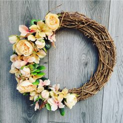 Peaches artificial silk flowered door wreath.