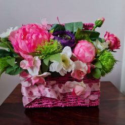 GIFT - FLORAL ARRANGEMENT - pink mini picnic basket filled with flowers