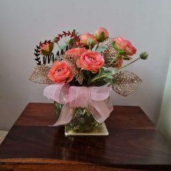 GIFT FOR MUM - FLORAL ARRANGEMENT-- coral ranunculus set in gold pearlescent opaque glass vase