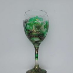 A wine glass. Hand painted resin art wine glasses (Emerald Forest)