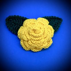 Handmade crochet rose flower brooch pin made from yellow 100% cotton yarn with crochet leaves