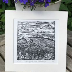 Rabbit print, Original limited edition linocut / lino print of a leaping Rabbit in a spring landscape