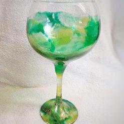 Gin glass, gin balloon in fresh greens, yellow and gold