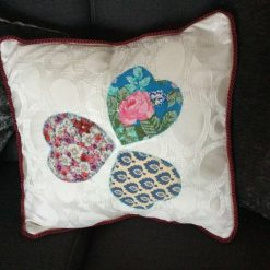 2 Cushion covers with Three Appliqué Hearts and matching piping. Dark pink envelope opening.