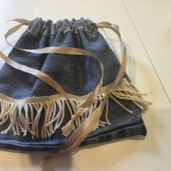 Reusable Medium Gift bag made with Recycled Denim Fabric Featuring  Tassel design.