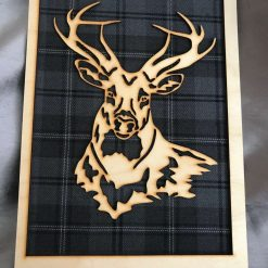 Image of Stag mounted on Grey Tartan with a simple Frame with Scotland on it