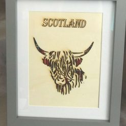 Outline of a Highland Coo on a Royal Stewart Tartan with a Grey Frame