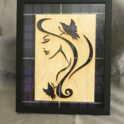 Stylised picture of a girl mounted on Purple Tartan with a Black Frame