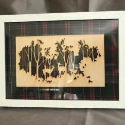 Outline of a Woodland Scene on a Green/Red Tartan with a White Frame