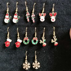 Christmas enamel charm gold plated fish hook earrings. Ideal gift or accessory. Variety of designs with limited stock