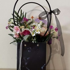 Artificial flower display in a gift bag large)