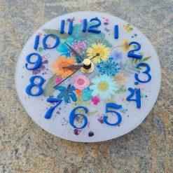 Flower Clock On A White Base