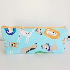 Pencil Case - Handmade - Light blue dog design cotton fabric with red & white gingham check cotton lining, orange zip.
