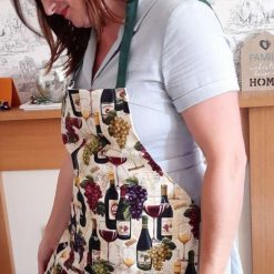 Apron. Handmade in a wine bottles and glasses print cotton fabric. Lined in plain cream. Green ties.