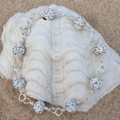 Handmade wirewrapped silver coloured beaded bracelet