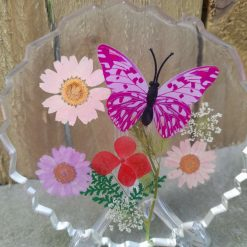 Handmade resin coaster with dried flowers and butterfly