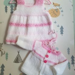 Handmade knitted baby dress and cardigan
