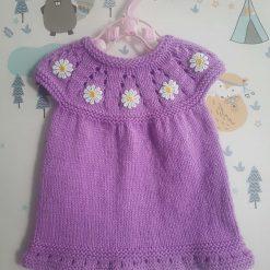 Handmade knitted girls dress with yoke detail