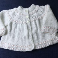 Hand knitted white baby cardigan