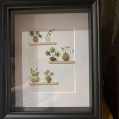 Pebble art, pots of flowers