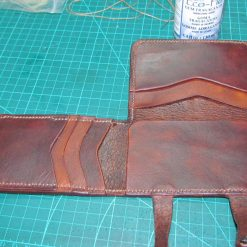 Tri-fold small leather wallet