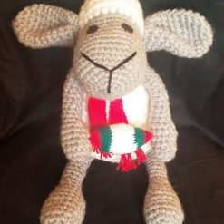 Handmade Crochet. Taffy the sheep with scarf and rugby ball.