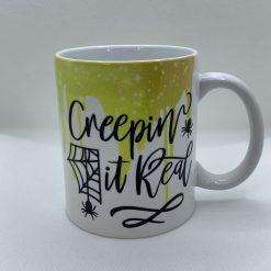 "Handmade Halloween Mug with slogan ""Creepin' it real"""