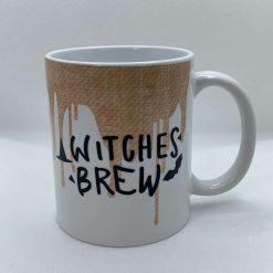 "Handmade Halloween Mug with slogan ""Witches Brew"""