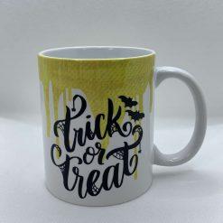 "Handmade Halloween Mug with slogan ""Trick or Treat"""