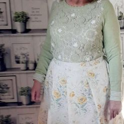 Apron. Handmade in 1950s pleated style floral fabric. Lined in plain lemon. Gift.