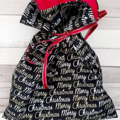 Christmas gift bag. Merry Christmas design. Black & gold. Red ribbon tie. Eco-friendly. Reuseable
