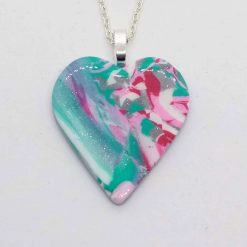 Green, pink, white and silver marbled heart shaped pendant