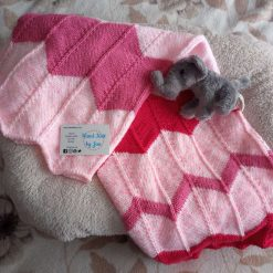 Hand knitted pink chevron baby blanket